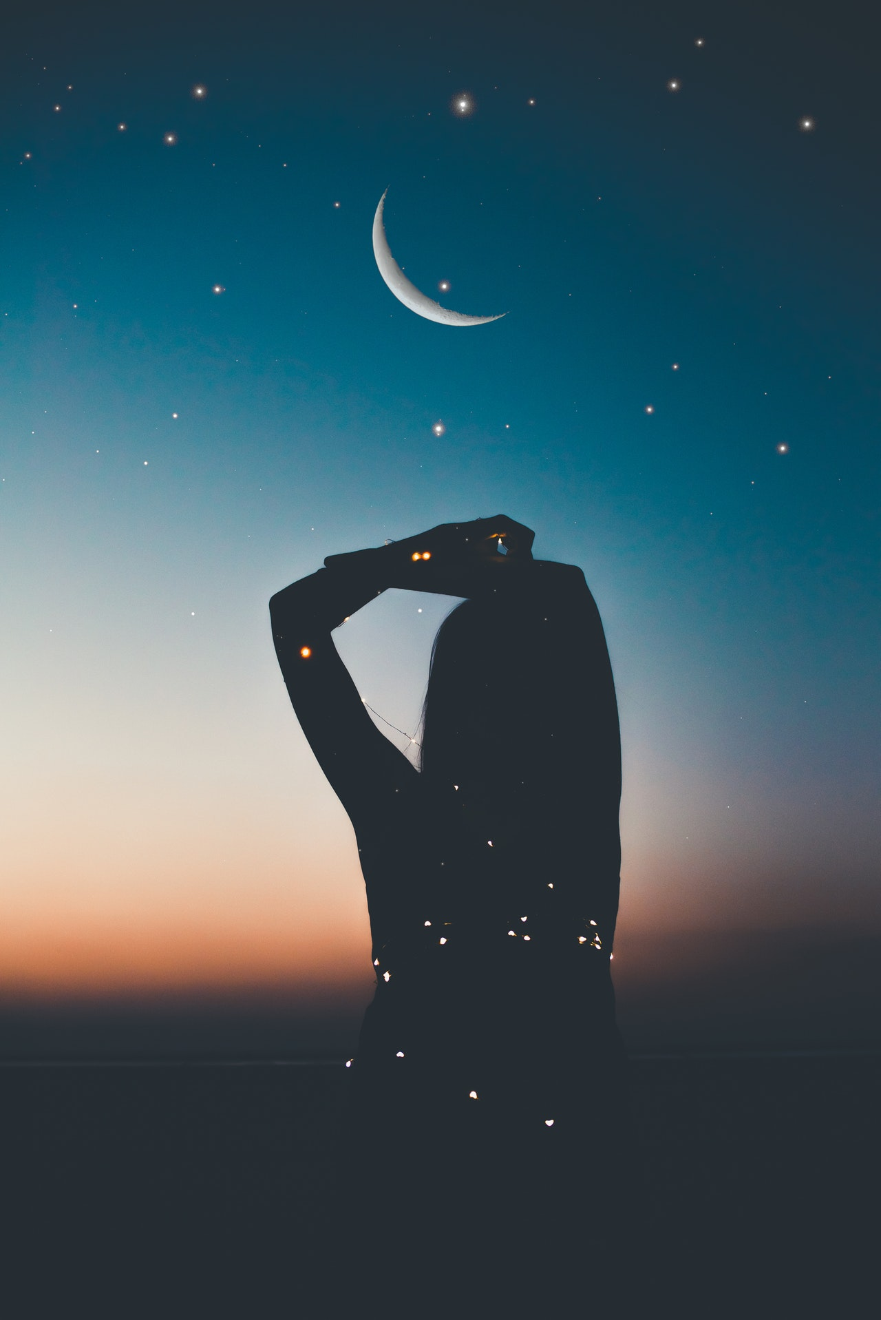 https://www.pexels.com/photo/silhouette-of-person-under-starry-night-artwork-1649079/